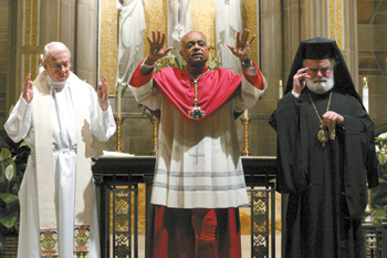 Archbishop-emeritus John F. Donoghue, left, and Metropolitan Alexios, right, join Archbishop Wilton D. Gregory for a final blessing of the congregation. (Photo by Michael Alexander)