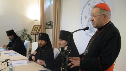 Alexander Siniakov, the seminary's director sits to the left of Abp. Hilarion