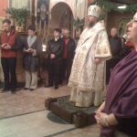 Metropolitan Jonah addresses the marchers at a prayer vigil the night before the march