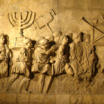 Roman soldiers carrying the Golden Menorah as plunder.