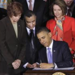 President Barack Obama signs the Don't Ask, Don't Tell Repeal Act of 2010. (AP Photo/Pablo Martinez Monsivais)