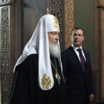 Russian Orthodox Patriarch Kirill (left) with President Dmitry Medvedev at the Church of Our Lady's Nativity in the Kremlin