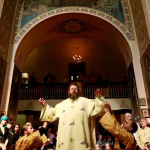 Metropolitan Jonah, center, is vested by Subdeacon Brother Gregory, left, and Subdeacon Gregory Lardin before a 2009 service at Holy Trinity Cathedral in Chicago. (Stacey Wescott, Chicago Tribune / July 26, 2009)