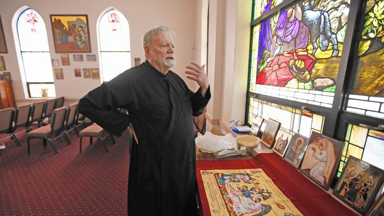 The Rev. Patrick Henry Reardon of All Saints Antiochian Orthodox Church in Chicago says the government can define and sanction marriage on its terms but that he'll no longer act as an agent of the government by signing civil licenses. (Phil Velasquez, Chicago Tribune)
